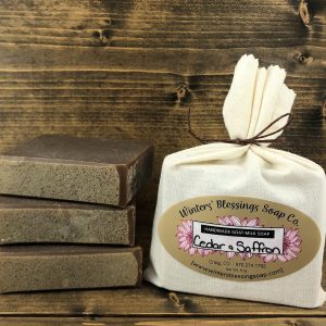 Packaged and not packaged Cedar and Saffron Goat Milk Soap